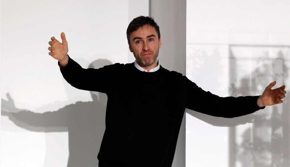 File photo of Simons acknowledging audience applauses at the end of the Jil Sander 2012 Autumn/Winter collection show during Milan Fashion Week
