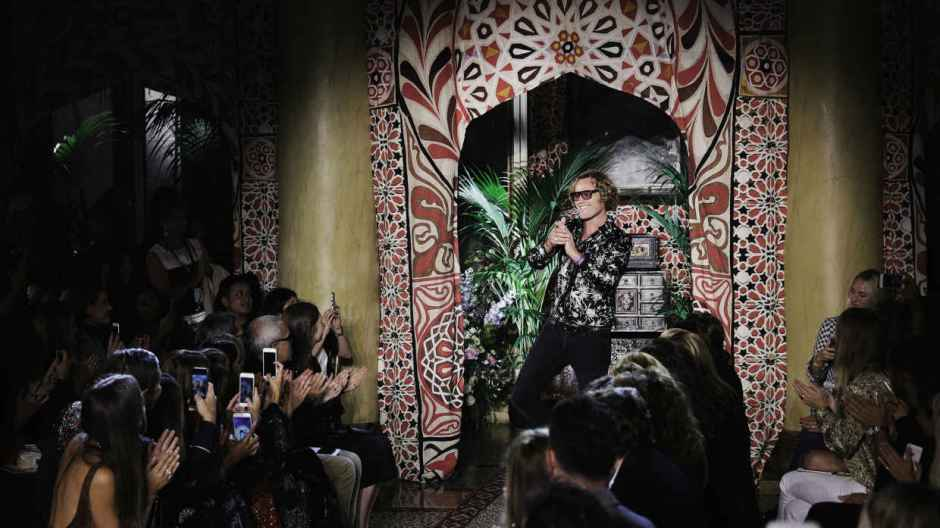 Peter Dundas takes his final bow after Roberto Cavalli's spring 2017 show in September